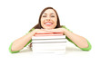 smiling student girl resting on the stack of books