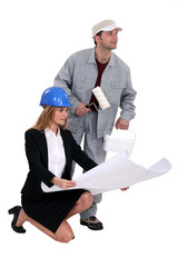 Architect kneeling by decorator