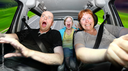 Funny family riding in a car.