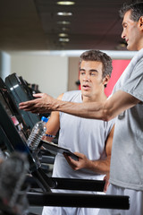 Man Asking About Machines In Gym