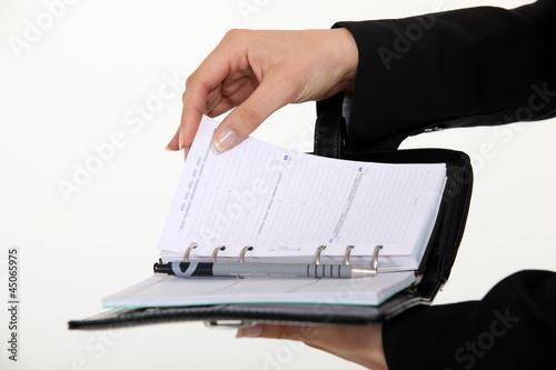 secretary holding an agenda