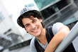 Portrait of cheerful young man standing in street