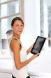 Businesswoman standing in office with digital tablet