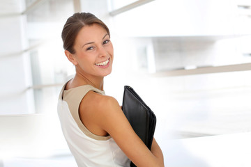 Smiling businesswoman in building hall