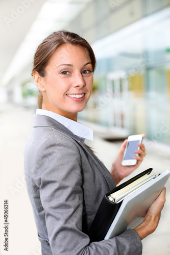 Attractive businesswoman standing outside
