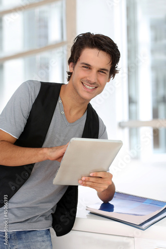 College student using digital tablet at school