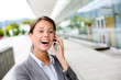 Cheerful businesswoman smiling on the phone