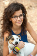 Young attractive girl with her dog.