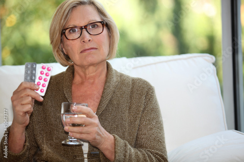 Woman about to take her medication