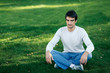 Relaxed man sitting in lotus position with closed eyes