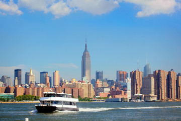 Ferry and Manhattan skyline in background, New York City