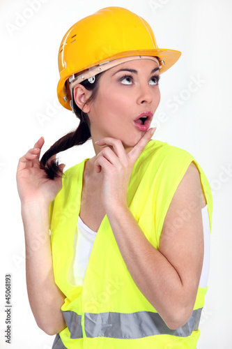 Woman with yellow helmet
