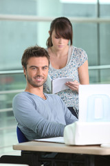 Man and woman with printer