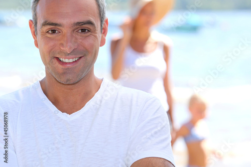 Man on holiday with his family
