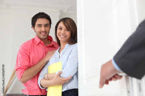 Young couple with an estate agent