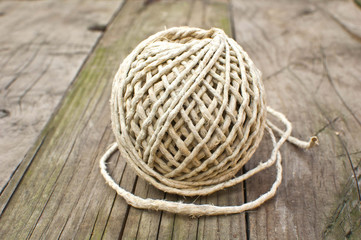 Rope knot on wooden background