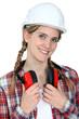 young craftswoman wearing earphones