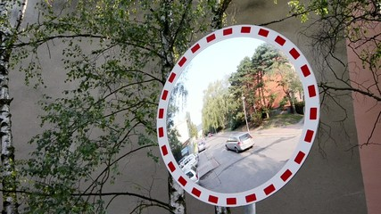 roadside mirror and cars driving