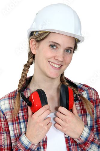 young craftswoman wearing earphones