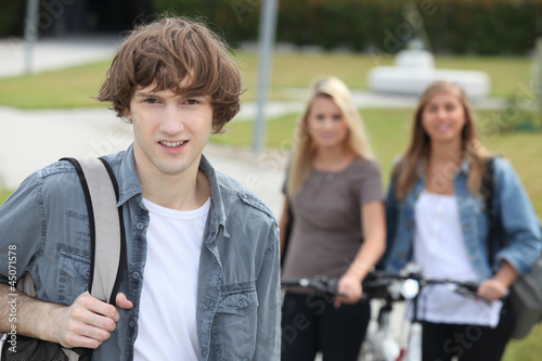 Man standing in front of girls