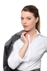 Business woman holding jacket over shoulder