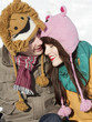 """Orem, Utah, USA, boyfriend and girlfriend wearing funny knit hats, embracing"""