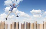 Man jumping over books - Fine Art prints
