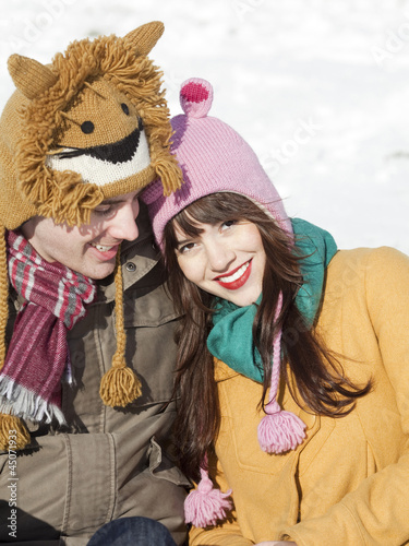 """Orem, Utah, USA, boyfriend and girlfriend wearing funny knit hats, portrait"""