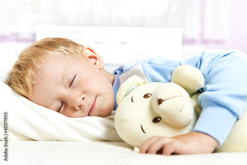 Small child sleeping in bed
