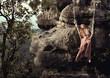 Sexy woman sitting on hillside