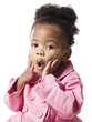Studio portrait of baby girl (18-23 months) wearing pink coat