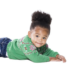 Studio portrait of baby girl (18-23 months) lying on front