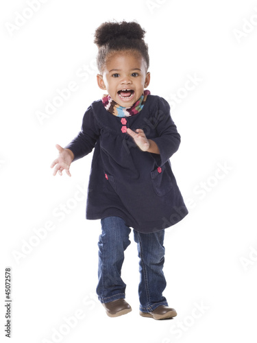 Studio portrait of baby girl (18-23 months) dancing