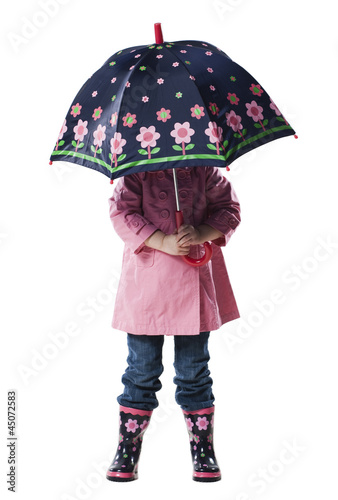 """Girl (2-3 years) holding umbrella over head, studio shot"""