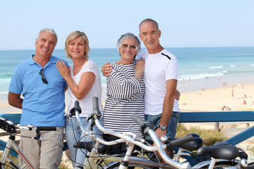 Portrait of four people at the beach with bikes