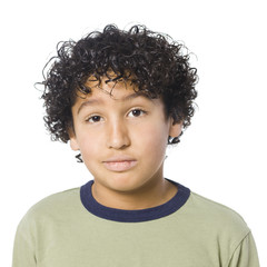 Studio portrait of boy (8-9) with curly hair