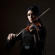 """Young woman playing violin, studio shot"""