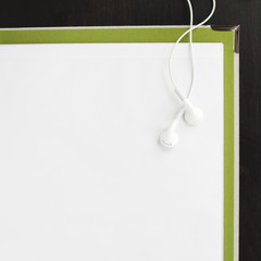 Earphones and blank paper on file
