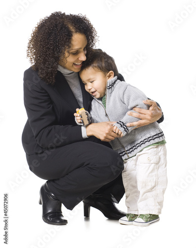 """Mother embracing son (18-23 months), studio shot"""