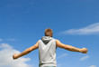 Guy in sports clothing on blue sky background