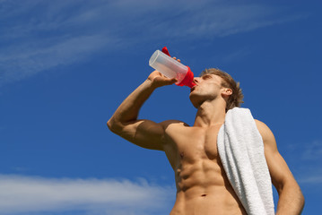 Young athlete drinking water