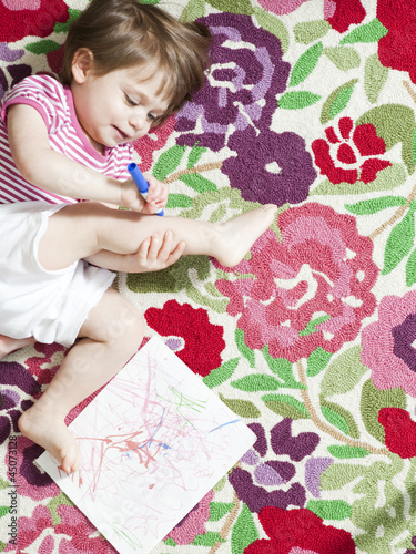 """USA, California, San Francisco, girl (2-3) playing with felt tip pen"""