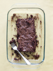 """Chocolate cake with fork in tray, directly above"""