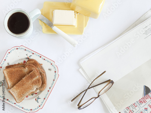 """USA, California, San Franciso, overhead view of breakfast and newspaper"""