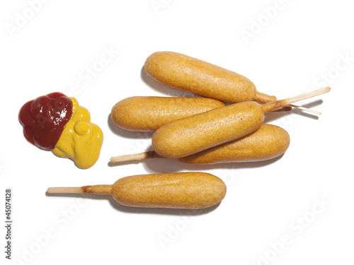 """Corndogs with ketchup and mustard, view from above, studio shot"""