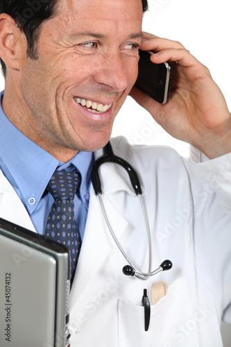 Doctor speaking on mile telephone