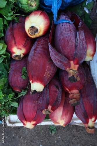 Ripe purple banana flowers selling on the food market in Asia