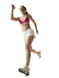 """Young woman running, on white background"""