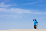 """USA, Utah, Little Sahara, man with skiwear standing in desert"""