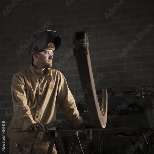 """USA, Utah, Orem, male welder in workshop"""
